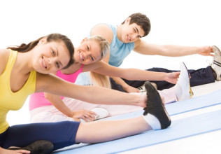 Portrait of young female doing stretching exercise among other people